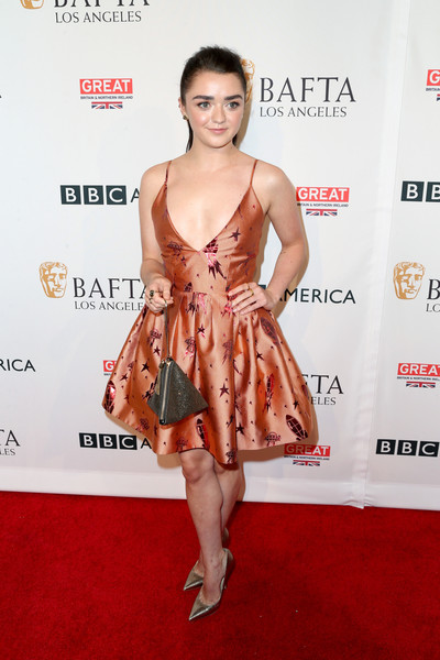 Maisie Williams teamed her cute frock with pointy gold pumps.