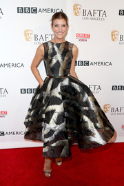 Kate Walsh wowed in a custom printed gazar dress by Christian Siriano at the BAFTA Los Angeles TV Tea Party.