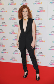 Jess Glynne sealed off her cool ensemble with modern black peep-toes.