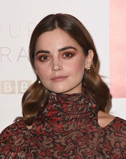 Jenna-Louise Coleman went edgy with a smoky application of red eyeshadow.