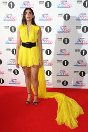 Dua Lipa stole the spotlight with this canary-yellow watteau-train mini dress by Giambattista Valli Couture at the 2017 BBC Radio 1 Teen Awards.