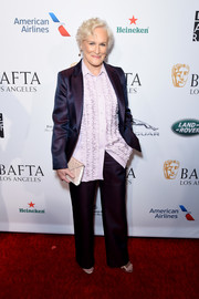 Glenn Close opted for this purple pantsuit and lilac ruffle shirt combo when she attended the BBCA BAFTA Tea Party.