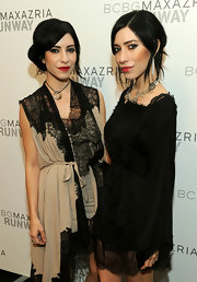 Lisa Origliasso wore a necklace with hoop pendant at the BCBG spring fashion show.