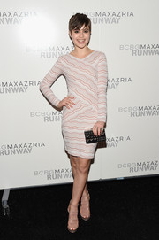 Sami Gayle's geometric-patterned, mirrored box clutch added an ultra-modern touch to her ensemble.