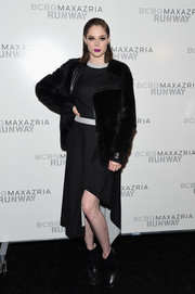 Coco Rocha styled her dress with a touch-chic fur jacket, also by BCBG Max Azria.