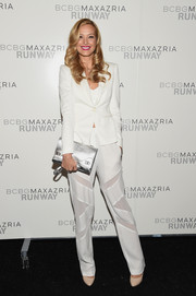 Petra Nemcova accessorized with a sassy silver clutch for a dose of shine to her look.