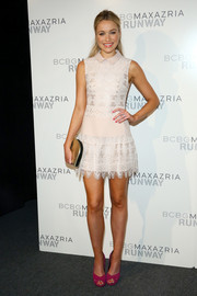Katrina Bowden finished off her look with a metallic gold clutch.