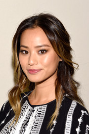 Jamie Chung looked romantic wearing this loose half-up do at the BCBG Max Azria fashion show.