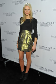 Katrina Bowden balanced out her metallic mini dress with black leather ankle boots.