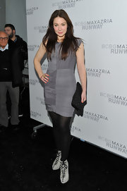 Lynn donned a silver textured cocktail dress with opaque tights and lace-up ankle boots at the BCBG runway show.