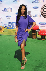 Michelle Williams was a standout on the carpet at the BET Awards in a vibrant purple cocktail dress with a golden underskirt.
