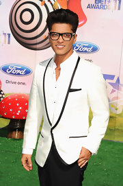 Geek has never looked so chic as it does here on Bruno Mars, who hit the 2011 BET Awards in a dapper white blazer with a shawl collar and black trim.
