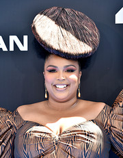 Lizzo topped off her ensemble with a funky disc hat.