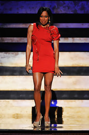 Regina King flashed a lot of leg in a modern red mini dress with asymmetrical sleeves at the 2012 Black Girls Rock event.