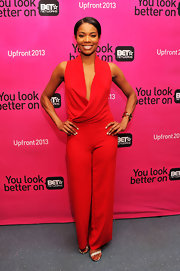 Gabrielle Union took the plunge with a candy apple red jumpsuit that featured a daring, draped neck.