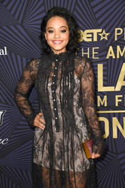 Kiersey Clemons attended the American Black Film Festival Honors sporting a metallic box clutch and lace dress combo.