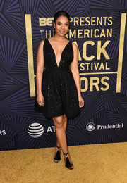 Regina Hall complemented her LBD with black tassel sandals.