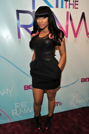 Nicki paired her leather clad Elizabeth and James dress with lace up ankle boots.