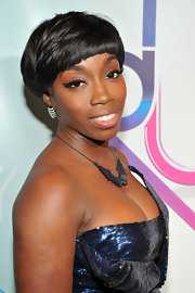 Estelle paired her sequined dress with an angel wing necklace.