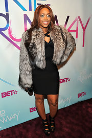 Rap star Trina showed us her extravagant side in a fur cropped jacket. She topped off her fur-clad look with a pair of chunky platform heels.