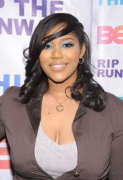 Kai Ray added a dash of color to her natural look with shimmering blue shadow rimmed around her upper and lower lids.
