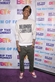 Wiz Khalifa wore a pair of red canvas shoes for the BET Rip the Runway purple carpet.