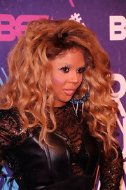 Lil Kim wore dangerous looking silver hoop earrings with bead and spike details at Rip the Runway 2012.