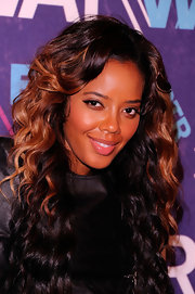 Angela Simmons attended BET's 2012 Rip the Runway wearing glossy bubblegum pink lipstick.