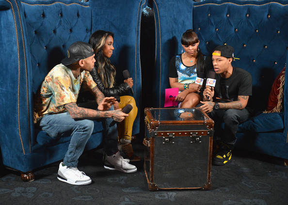 Chris Brown was interviewed while wearing a pair of slick white sneakers.