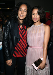 Gugu Mbatha-Raw paired a pink and gold Lee Savage box clutch with a sweet lilac dress for the Urbanworld Film Festival.