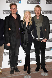 At the 'Anonymous' photocall, Joely Richardson donned a black silk tie-front blouse paired with black suede knee-high boots.