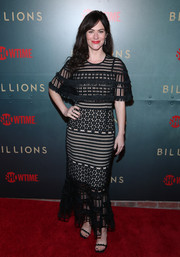 Maggie Siff cut a chic figure in a black lace maxi dress with a nude underlay at the premiere of 'Billions' season 3.