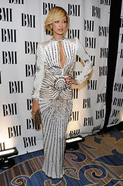Keri Hilson teamed her dazzling crystal-encrusted gown with a bronze Swarovski Power clutch.