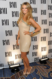 Delta Goodrem looked alluring at the BMI Pop Music Awards in a shimmery nude one-shoulder dress with a bejeweled neckline.