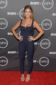 Jessie James Decker teamed her sexy jumpsuit with the iconic Jimmy Choo Lance sandals, in gold.
