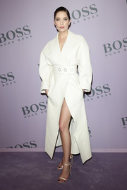 Ashley Benson wore a crisp white coat by Boss during the brand's Fall 2020 show.