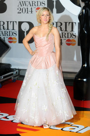 Ellie Goulding stepped out on the Brit Awards red carpet looking like a princess in a Vivienne Westwood strapless gown with a pink bodice and a voluminous white skirt.