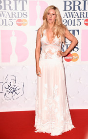Ellie Goulding went for a perfect feminine look for the BRIT Awards in a full-length white gown with a sheer detail.
