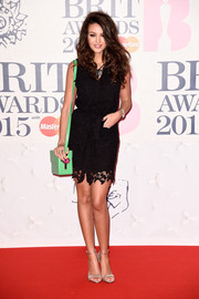 Michelle Keegan styled her dress with elegant silver ankle-strap sandals.