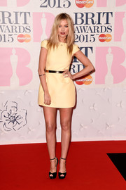 Laura Whitmore chose a cute pastel yellow mini dress for the BRIT Awards.