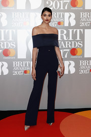 Neelam Gill was svelte and chic at the Brit Awards in a navy off-the-shoulder jumpsuit by Galvan.