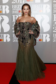 Rita Ora donned a show-stopping Alexandre Vauthier Couture gown, featuring a heavily beaded bodice and a see-through skirt, for the Brit Awards.