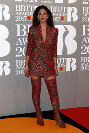 Nicole Scherzinger looked sassy in an embellished red tuxedo dress by Nicolas Jebran at the Brit Awards.