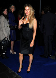 Ellie Goulding turned heads in a low-cut black corset dress at the Universal Music party for the Brit Awards.