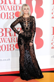 Lottie Moss hit the 2018 Brit Awards rocking a sheer black gown by Zuhair Murad.