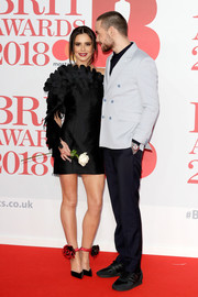 Cheryl looked fashion-forward in this richly textured, asymmetrical LBD by Jean-Louis Sabaji at the 2018 Brit Awards.