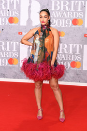 Jorja Smith went for a graphic halter dress with a feather hem at the 2019 Brit Awards.
