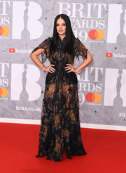 Lily Allen went goth in a sheer floral maxi dress by Coach teamed with sleek raven tresses at the 2019 Brit Awards.