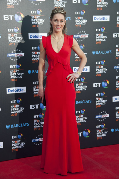 Amy Williams chose a stunning red gown with a ruffled waist for her red carpet look at the BT Sports Industry Awards.