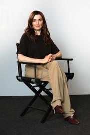 Rachel Weisz teamed her shirt with loose khaki slacks by Michael Kors.